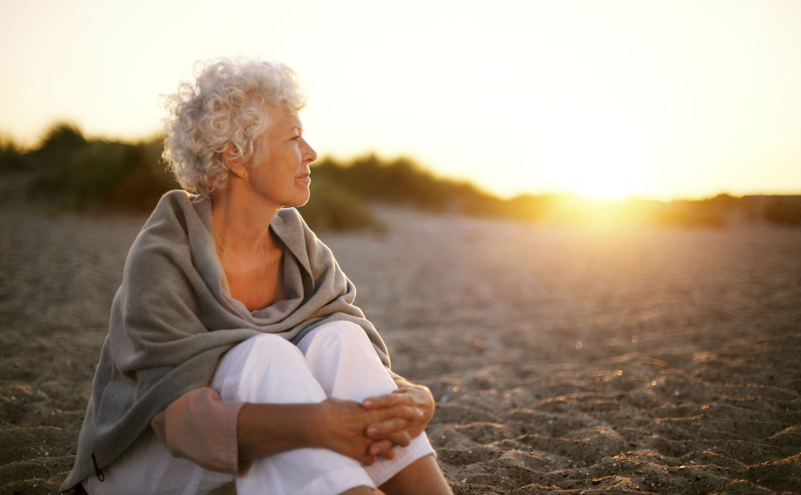 mature-woman-on-beach-looking-into-horizon-final